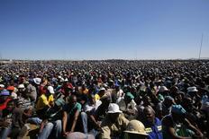 Striking platinum miners attend a rally near Lonmin's Marikana mine April 29, 2014. REUTERS/Mike Hutchings