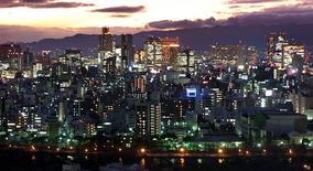 The skyline of Osaka is seen in this February 8, 2001 file photo. REUTERS/Kimimasa Mayama/Files