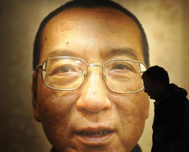Workers prepare the Nobel Peace Prize laureate exhibition ''I Have No Enemies'' for Chinese dissident Liu Xiaobo at the Nobel Peace Center in Oslo December 9, 2010. REUTERS/Toby Melville