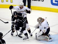 May 10, 2014; Los Angeles, CA, USA; Anaheim Ducks goalie John Gibson (36) and defenseman Cam Fowler (4) defend the goal against Los Angeles Kings center Jarret Stoll (28) in the second period in game four of the second round of the 2014 Stanley Cup Playoffs at Staples Center. Mandatory Credit: Kirby Lee-USA TODAY Sports