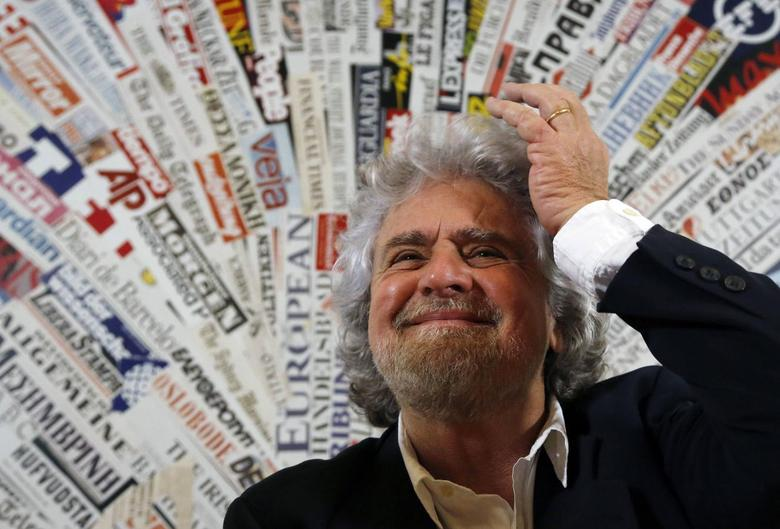 The 5-Star Movement leader and comedian Beppe Grillo gestures before a news conference for foreign press in downtown Rome January 23, 2014. REUTERS/Stefano Rellandini