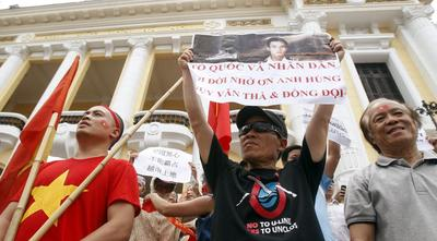 Rare rallies in Vietnam say 'hands off' to China over...