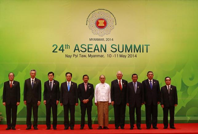 ASEAN leaders pose for pictures during the opening ceremony of the 24th ASEAN Summit in Naypyidaw May 11, 2014. From left, the leaders are: Philippines President Benigno Aquino, Singapore Prime Minister Lee Hsien Loong, Thailand Deputy Prime Minister Phongthep Thepkanjana, Vietnam Prime Minister Nguyen Tan Dung, Brunei Sultan Hassanal Bolkiah, Myanmar President Thein Sein, Malaysia Prime Minister Najib Razak, Cambodia Prime Minister Hun Sen, Indonesia President Susilo Bambang Yudhoyono and Laos Prime Minister Thongsing Thammavong. REUTERS/Soe Zeya Tun