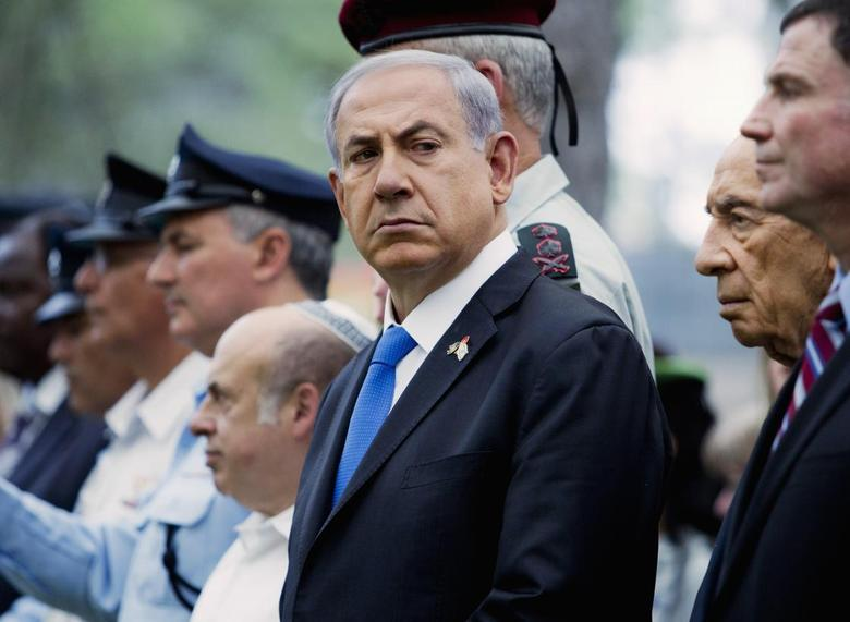 Israel's Prime Minister Benjamin Netanyahu attends a ceremony marking the Fallen Soldiers Memorial Day held on Mount Herzl Military Cemetery in Jerusalem, May 5, 2014. REUTERS/Jim Hollander/Pool