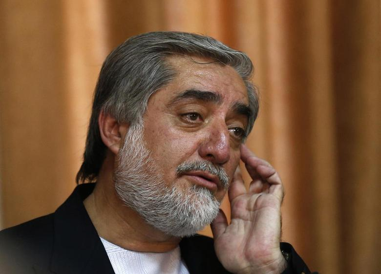 Afghan presidential candidate Abdullah Abdullah reacts during a news conference in Kabul April 27, 2014. REUTERS/Mohammad Ismail