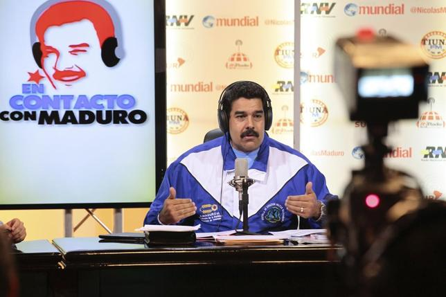Venezuela's President Nicolas Maduro speaks during his weekly broadcast ''en contacto con Maduro'' at Miraflores Palace in Caracas, in this May 6, 2014 handout provided by the Miraflores Palace. REUTERS/Miraflores Palace/Handout via Reuters