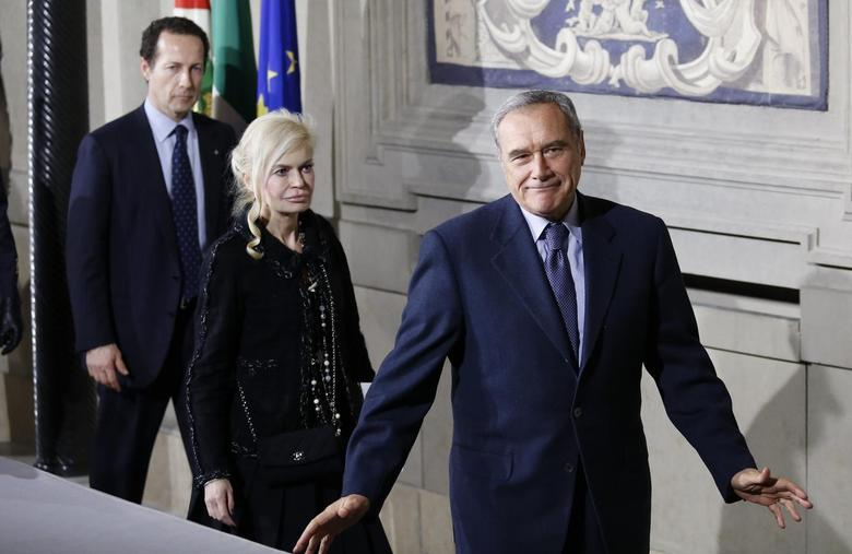 Italy's upper house President Pietro Grasso (R) gestures as he leaves at the end of the first day of consultations with Italian President Giorgio Napolitano at the Quirinale Palace in Rome February 14, 2014. REUTERS/Remo Casilli