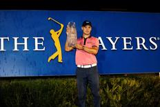 May 11, 2014; Ponte Vedra Beach, FL, USA; Martin Kaymer celebrates with the trophy after winning The Players Championship at TPC Sawgrass - Stadium Course. Mandatory Credit: Geoff Burke-USA TODAY Sports