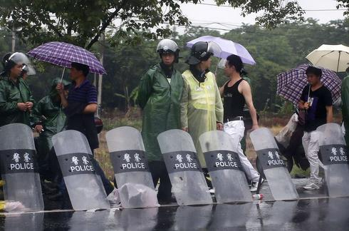 Chinese police hunt protesters after waste plant clash