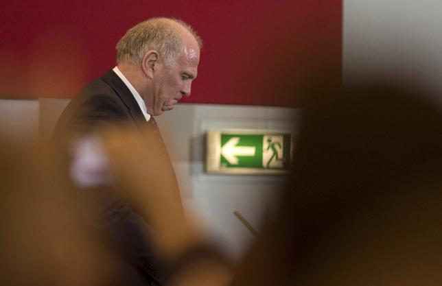Bayern Munich's former President Uli Hoeness leaves the stage during an extraordinary general meeting of the German Bundesliga first division soccer club in Munich May 2, 2014. REUTERS/Lukas Barth