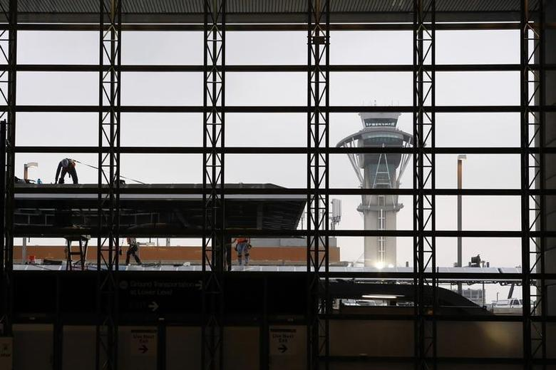 The air traffic control tower is seen through a window as construction workers work on the Tom Bradley International Terminal at Los Angeles International Airport (LAX), in Los Angeles, California April 24, 2013. REUTERS/Patrick T. Fallon
