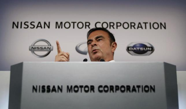 Nissan Motor Co's President and Chief Executive Officer Carlos Ghosn gestures as he speaks at a news conference at its headquarters in Yokohama, south of Tokyo May 12, 2014. REUTERS/Yuya Shino