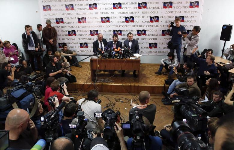 The separatist rebellion leadership, led by Denis Pushilin (C), attend a news conference in Donetsk, May 12, 2014. REUTERS/Maxim Zmeyev