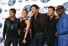"Singers and judges Keith Urban (L), Jennifer Lopez and Harry Connick, Jr. (C) pose with host Ryan Seacrest (2nd R) and producer Randy Jackson at the party for the finalists of ""American Idol XIII"" in West Hollywood, California February 20, 2014.   REUTERS/Mario Anzuoni"