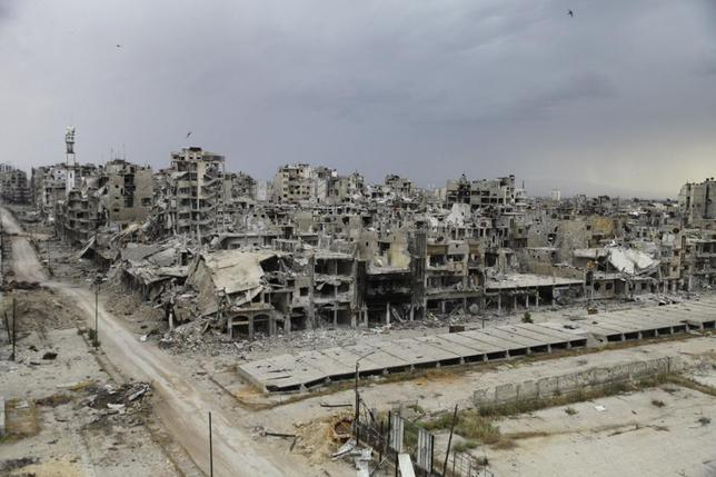Destroyed buildings are pictured, after the cessation of fighting between rebels and forces loyal to Syria's President Bashar al-Assad, in Homs city, May 10, 2014. REUTERS/Ghassan Najjar