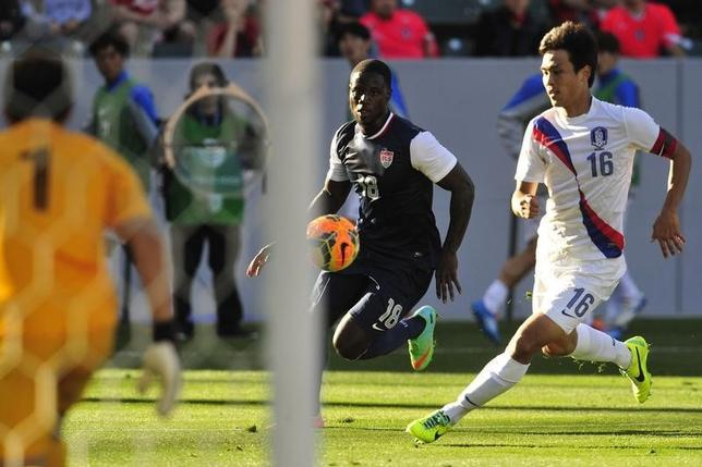 February 1, 2014; Carson, CA, USA; USA forward Eddie Johnson (18) moves in for a shot on net against Korea Republic during the second half at StubHub Center. Mandatory Credit: Gary A. Vasquez-USA TODAY Sports