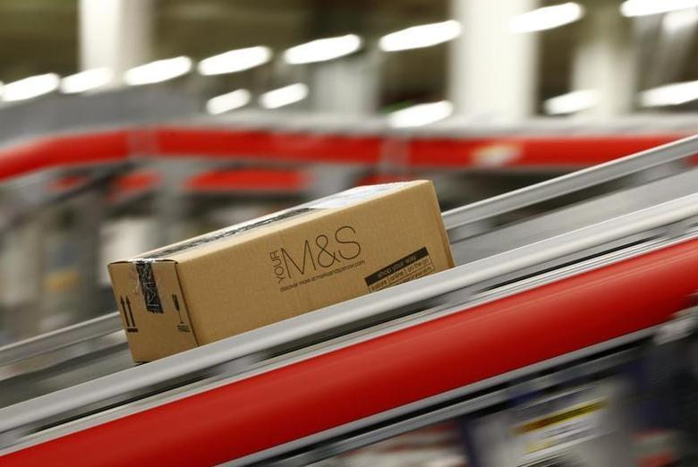 A parcel travels along a belt at the new Marks & Spencer e-commerce distribution centre in Castle Donington, central England May 8, 2013. REUTERS/Darren Staples