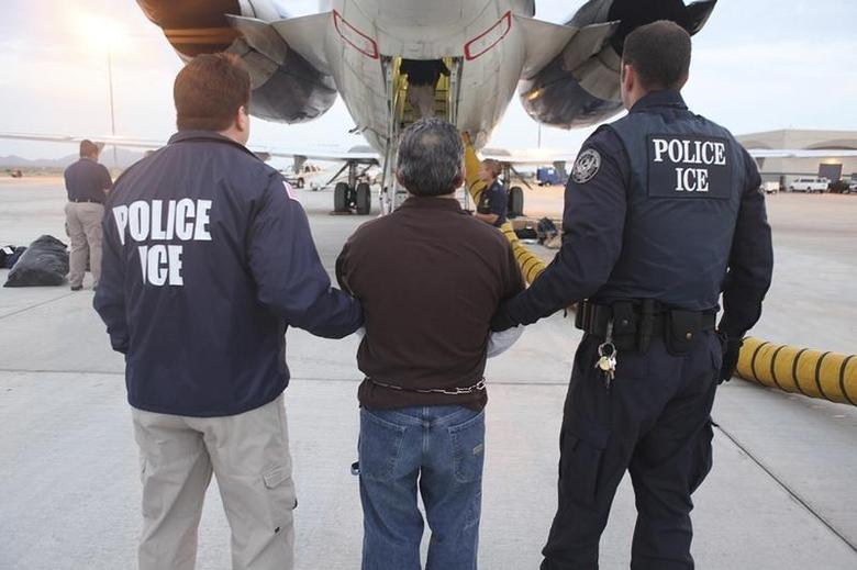 Pedro Pimentel Rios is transferred to an awaiting plane bound for Guatemala by U.S. Immigration and Customs Enforcement (ICE) officials at Phoenix Mesa Gateway airport in Mesa, Arizona, in this handout photo released to Reuters July 12, 2011. REUTERS/ICE/Handout