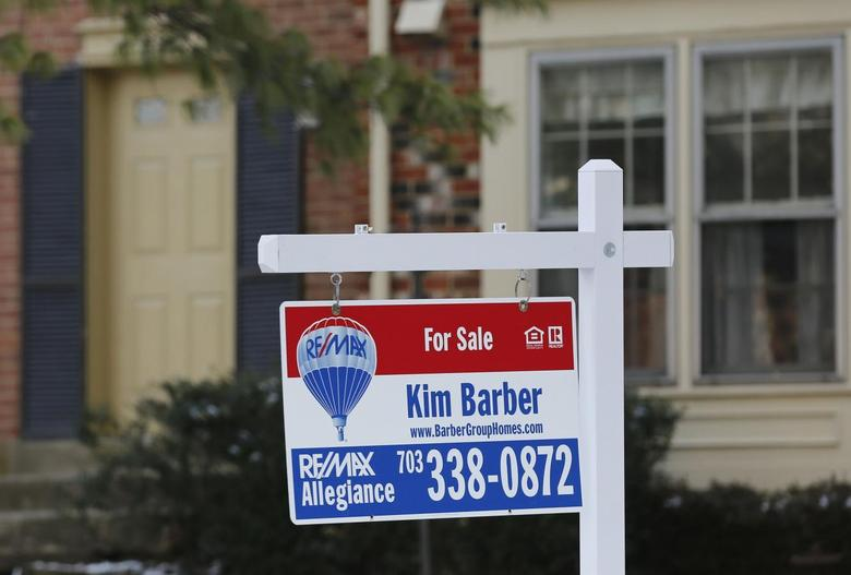 A townhouse for sale sign hangs in front of a house in Oakton, Virginia March 27, 2014. REUTERS/Larry Downing