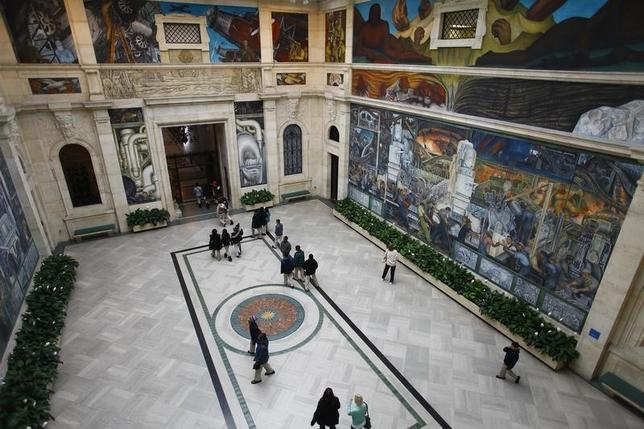 People at a mural by artist Diego Rivera at the Art Institute of Detroit in Detroit, Michigan December 3, 2013.  REUTERS/Joshua Lott