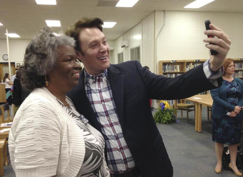 Democratic nominee Clay Aiken takes a pictures with a constituent after a campaign forum in Cary, North Carolina, April 28, 2014. REUTERS/Colleen Jenkins