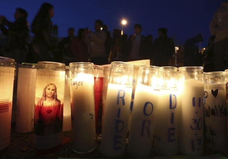 Fans gather near a makeshift shrine at an unofficial memorial event for ''Fast and Furious'' star Paul Walker in Santa Clarita, California December 8, 2013.  REUTERS/Jonathan Alcorn