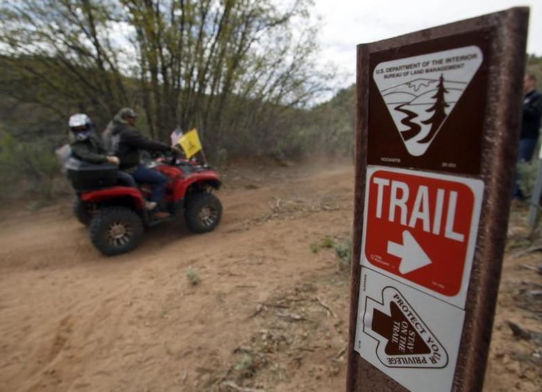 ATV riders ride past a trail sign in Recapture Canyon outside Blanding, Utah, May 10, 2014. REUTERS/Jim Urquhart