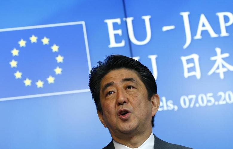 Japanese Prime Minister Shinzo Abe attends a news conference at the end of a EU-Japan Summit in Brussels May 7, 2014. REUTERS/Yves Herman