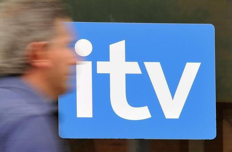 A man passes ITV television studios in central London August 3, 2010. REUTERS/Toby Melville
