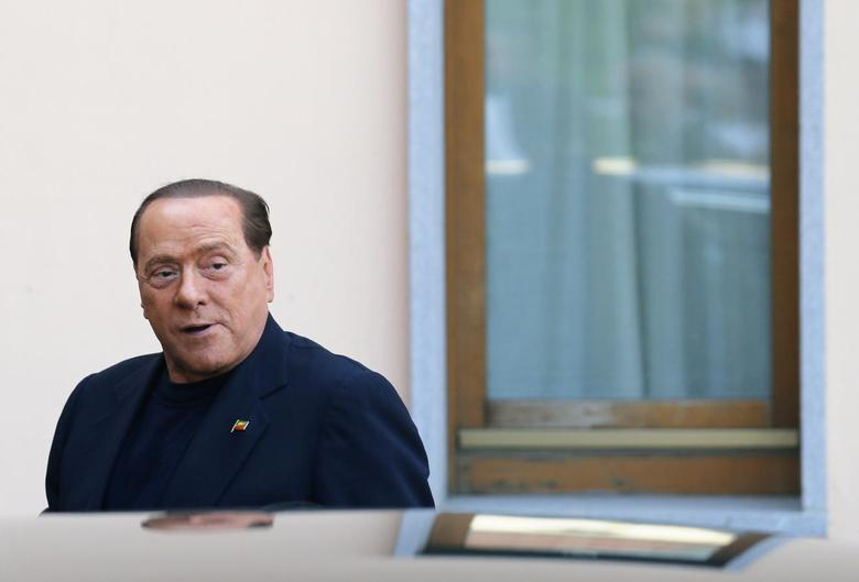 Former Italian Prime Minister Silvio Berlusconi looks on as he arrives at the Sacred Family Foundation, where he will serve part of his one-year tax fraud sentence by doing community service with the elderly, in Cesano Boscone, a small town on the outskirts of Milan May 9, 2014. REUTERS/Stefano Rellandini
