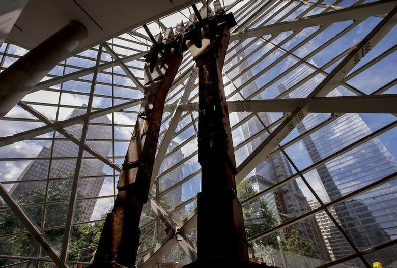 Two steel ''tridents'' recovered from the World Trade Center site after September 11, 2001, stand in the entry pavilion area of the 911 Memorial Museum, which is under construction, at the World Trade Center site in New York, July 2, 2013. REUTERS/Mike Segar