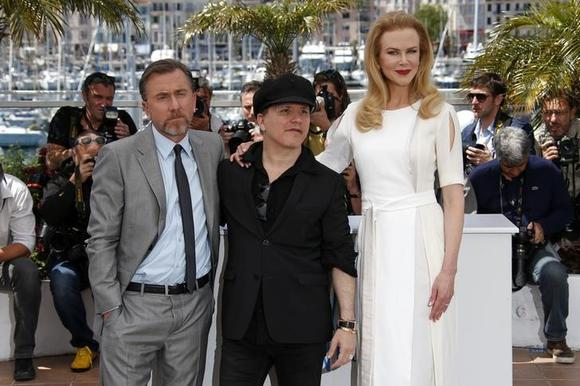 Director Olivier Dahan (C), cast members Nicole Kidman (R) and Tim Roth pose during a photocall for the film ''Grace of Monaco'' (Grace de Monaco) out of competition before the opening of the 67th Cannes Film Festival in Cannes May 14, 2014. REUTERS/Benoit Tessier