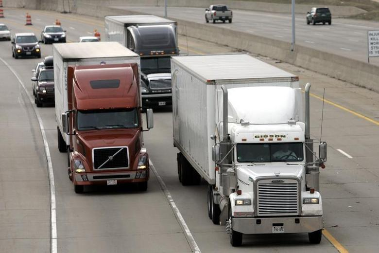 Two freight trucks are driven on the Fisher freeway in Detroit, Michigan March 27, 2009. REUTERS/Rebecca Cook