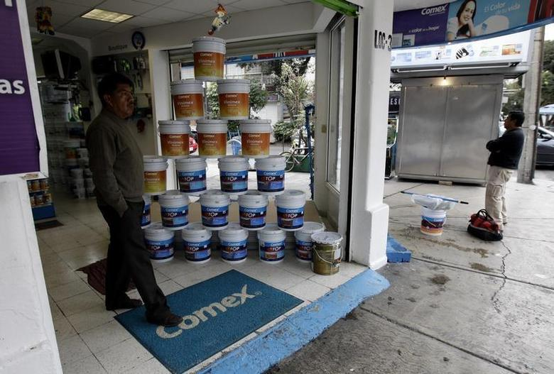 A man walks out of a Comex store in Mexico City November 13, 2012. REUTERS/Henry Romero