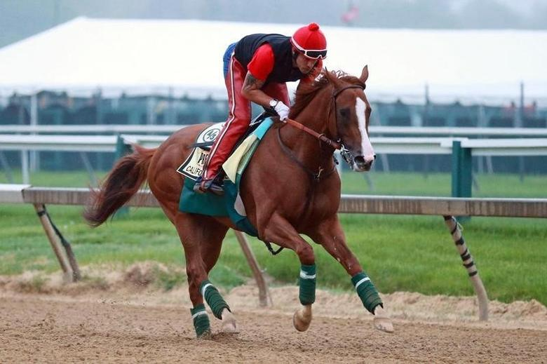 May 14, 2014; Baltimore, MD, USA; Exercise rider Willie Delgado aboard California Chrome during morning workouts in preparation for the Preakness Stakes at Pimlico Race Course. Mandatory Credit: Mitch Stringer-USA TODAY Sports