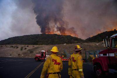 Wildfires menace southern California, thousands...