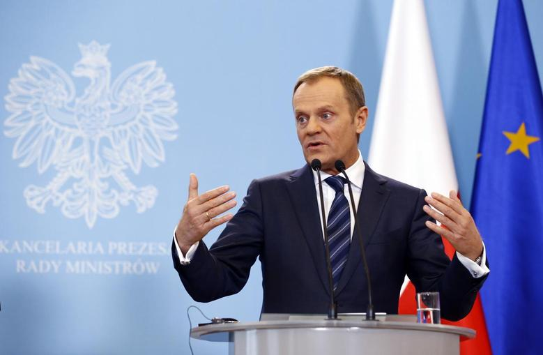 Polish Prime Minister Donald Tusk addresses to media after meeting German Chancellor Angela Merkel in Warsaw March 12, 2014. REUTERS/Kacper Pempel