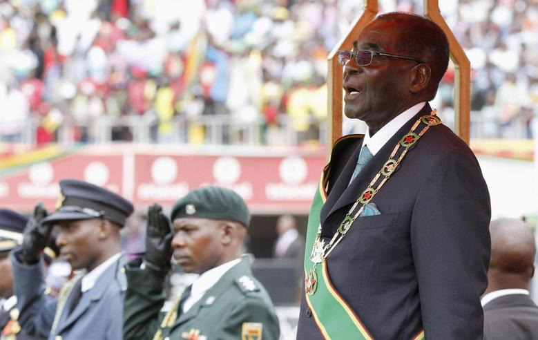 Zimbabwe's President Robert Mugabe stands during celebrations to mark his country's 34th Independence Day in Harare April 18, 2014. REUTERS/Philimon Bulawayo