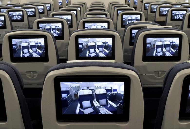 TV screens, installed on board of an Airbus A350 XWB flight-test aircraft are pictured during a media-day at the German headquarters of aircraft company Airbus in Hamburg-Finkenwerder, April 7, 2014. REUTERS/Fabian Bimmer