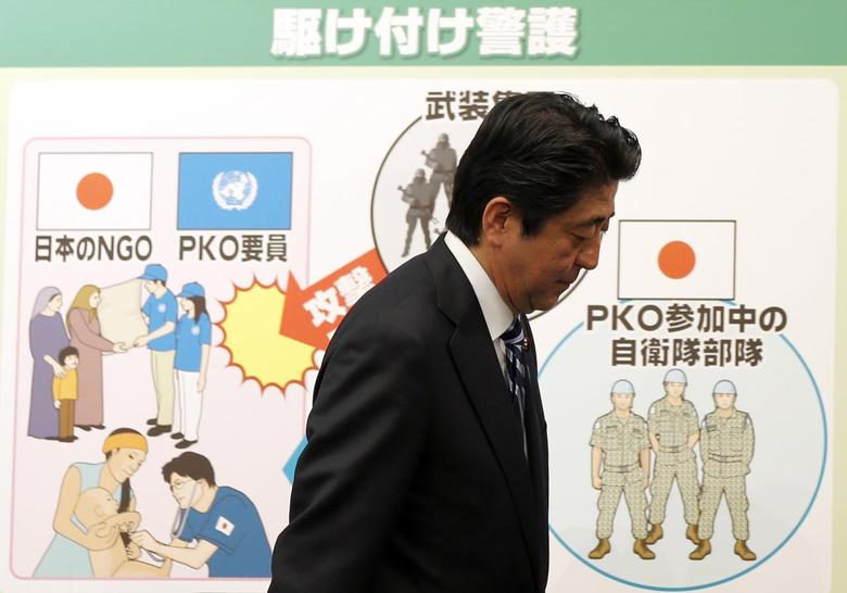 Japan's Prime Minister Shinzo Abe leaves a news conference at his official residence in Tokyo May 15, 2014. REUTERS/Toru Hanai