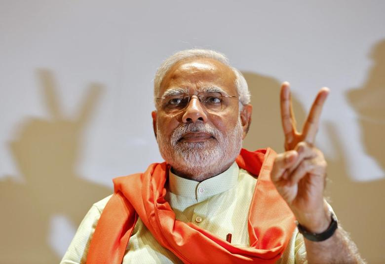 Hindu nationalist Narendra Modi, the prime ministerial candidate for India's main opposition Bharatiya Janata Party (BJP), gestures upon his arrival to meet his party leaders and workers at Gandhinagar in the western Indian state of Gujarat May 13, 2014. REUTERS/Amit Dave