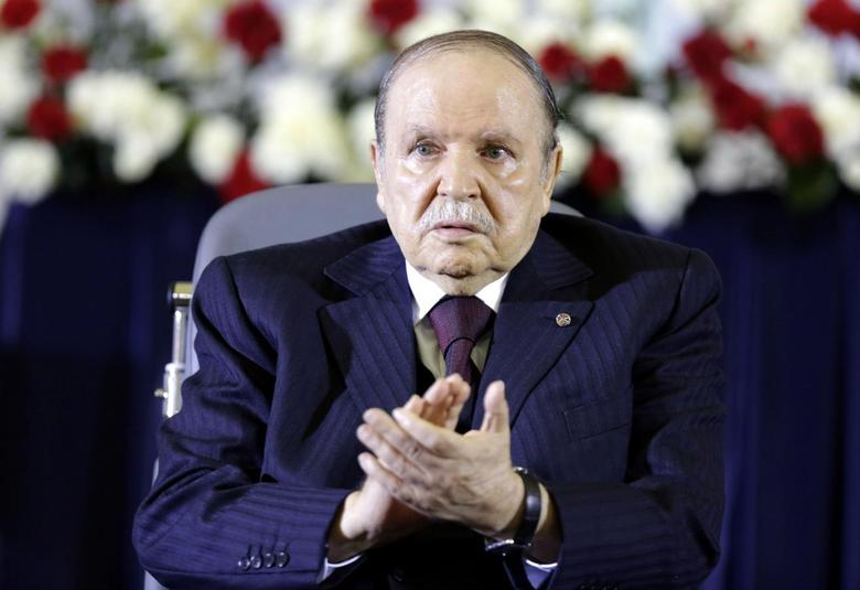 President Abdelaziz Bouteflika claps during a swearing-in ceremony in Algiers April 28, 2014. REUTERS/Louafi Larbi