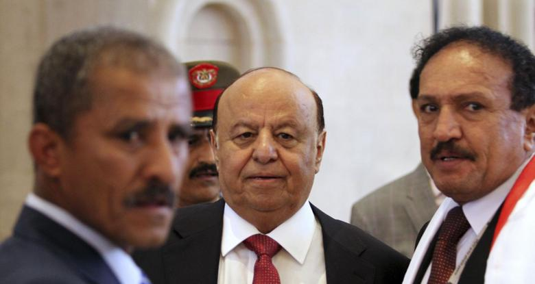 Yemen's President Abd-Rabbu Mansour Hadi (C) enters the hall during the closing ceremony of the national dialogue conference in Sanaa January 25, 2014. REUTERS/Mohamed al-Sayaghi