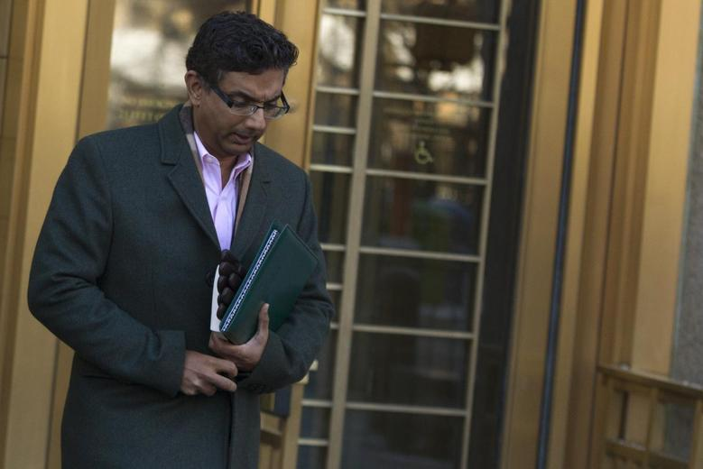 Conservative commentator and best-selling author, Dinesh D'Souza exits the Manhattan Federal Courthouse in New York, January 24, 2014. REUTERS/Brendan McDermid