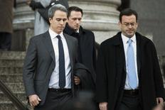 Michael Steinberg (L), a top portfolio manager at Steven A. Cohen's SAC Capital Advisors hedge fund, departs Federal Court in Manhattan after being found guilty on charges that he traded on insider information in New York December 18, 2013. REUTERS/Lucas Jackson