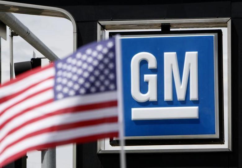 The U.S. flag flies at the Burt GM auto dealer in Denver June 1, 2009. RTEUTERS/Rick Wilking