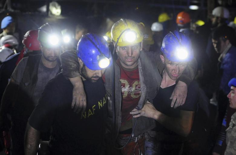 An injured miner is carried to an ambulance after being rescued from a coal mine he was trapped in, in Soma, a district in Turkey's western province of Manisa early May 14, 2014. REUTERS/Emre Tazegul
