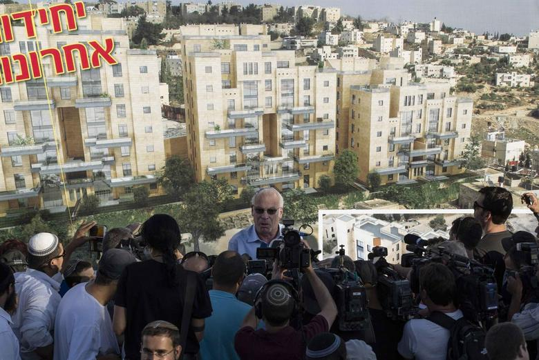 Israeli Housing Minister Uri Ariel speaks to reporters at a ceremony announcing the resumption of construction of an Israeli neighbourhood in East Jerusalem August 11, 2013. REUTERS/Ronen Zvulun