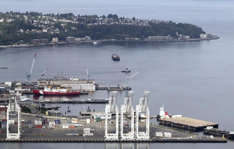 The shipping docks in the deepwater harbor of the Port of Seattle (foreground) and the West Seattle peninsula (background) is pictured in this aerial photograph taken from a helicopter in Seattle August 21, 2012. REUTERS/Anthony Bolante