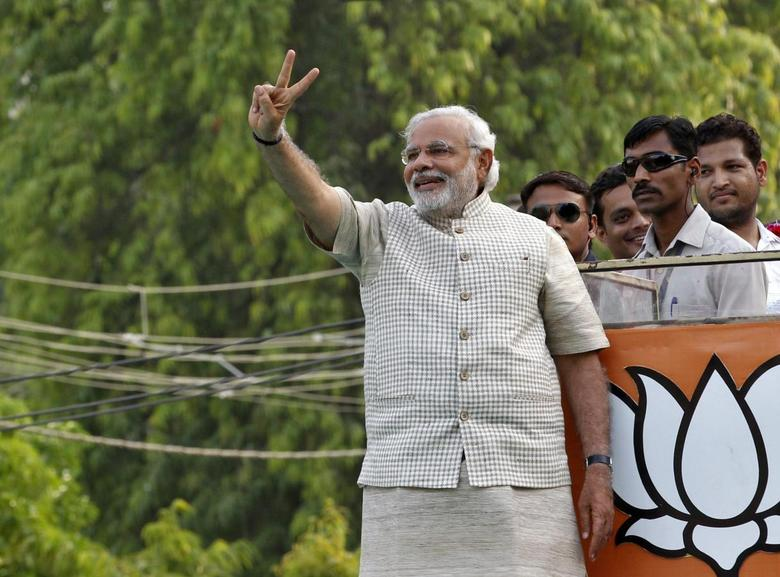 Hindu nationalist Narendra Modi, the prime ministerial candidate for India's main opposition Bharatiya Janata Party (BJP), gestures during a public meeting in Vadodra in the western Indian state of Gujarat May 16, 2014. REUTERS/Amit Dave